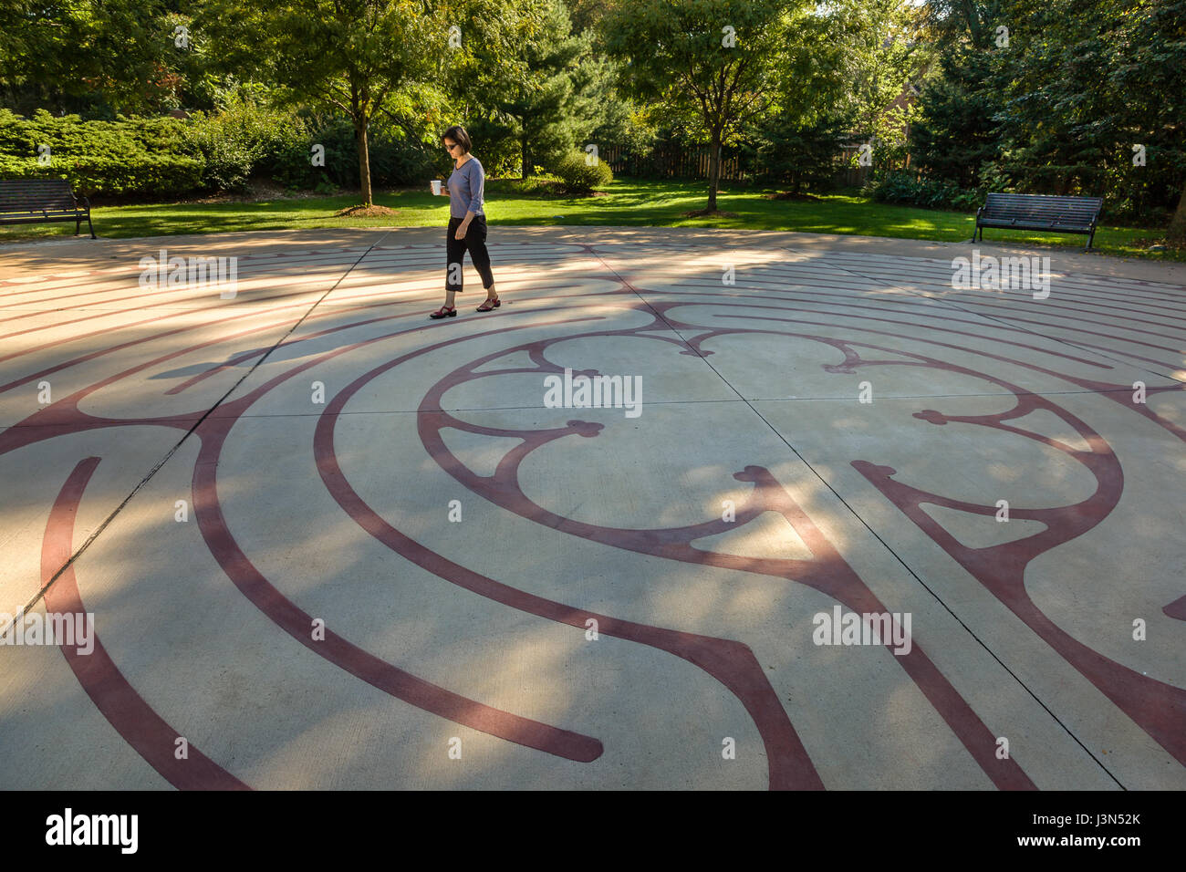One woman walking a labyrinth in Burlington Ontario, Central Park - Stock Image