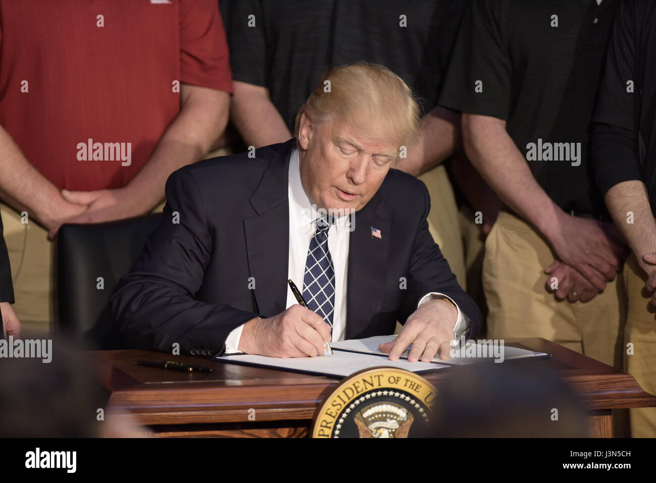 U.S. President Donald Trump signs an Executive Order repealing the Clean Power Plan during a ceremony at the Environmental - Stock Image