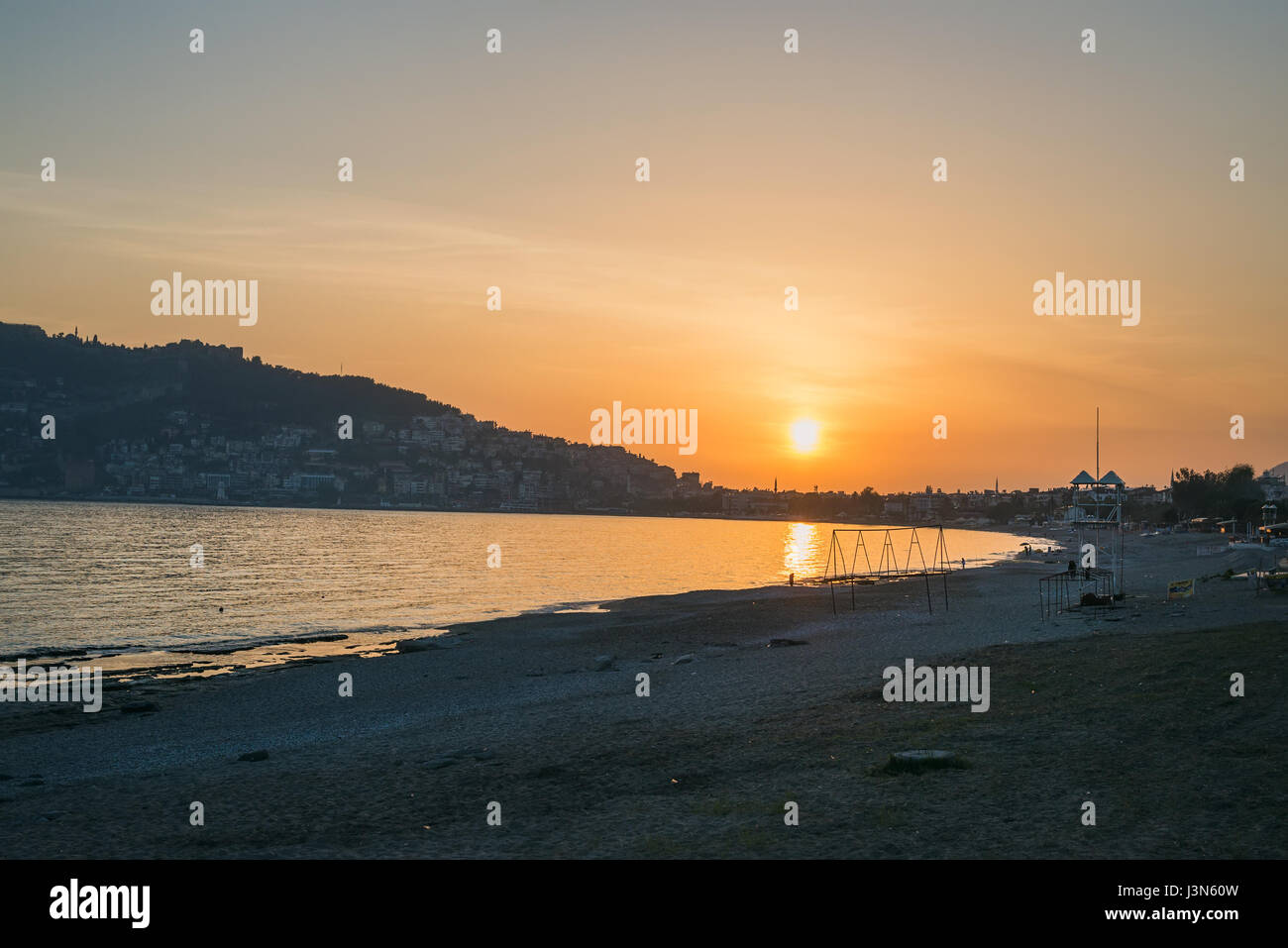 Sunset at the beach in Alanya, Turkey - Stock Image