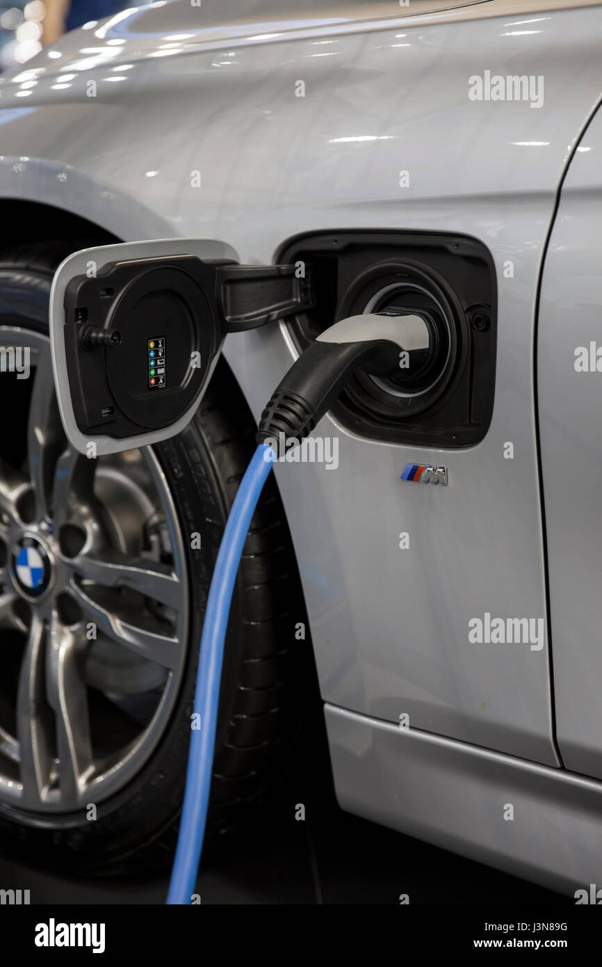 Recharging of hybrid BMW car. BMW ActiveHybrid technology unites a combustion engine and electric drive - Stock Image
