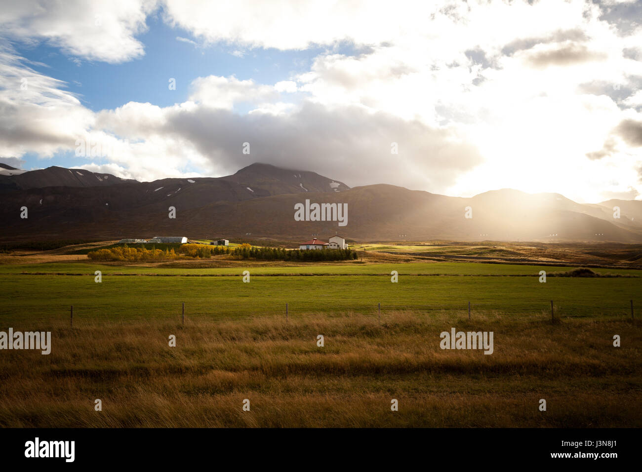 Beautiful landscape in Iceland. Countryside with light and mountain range. Stock Photo