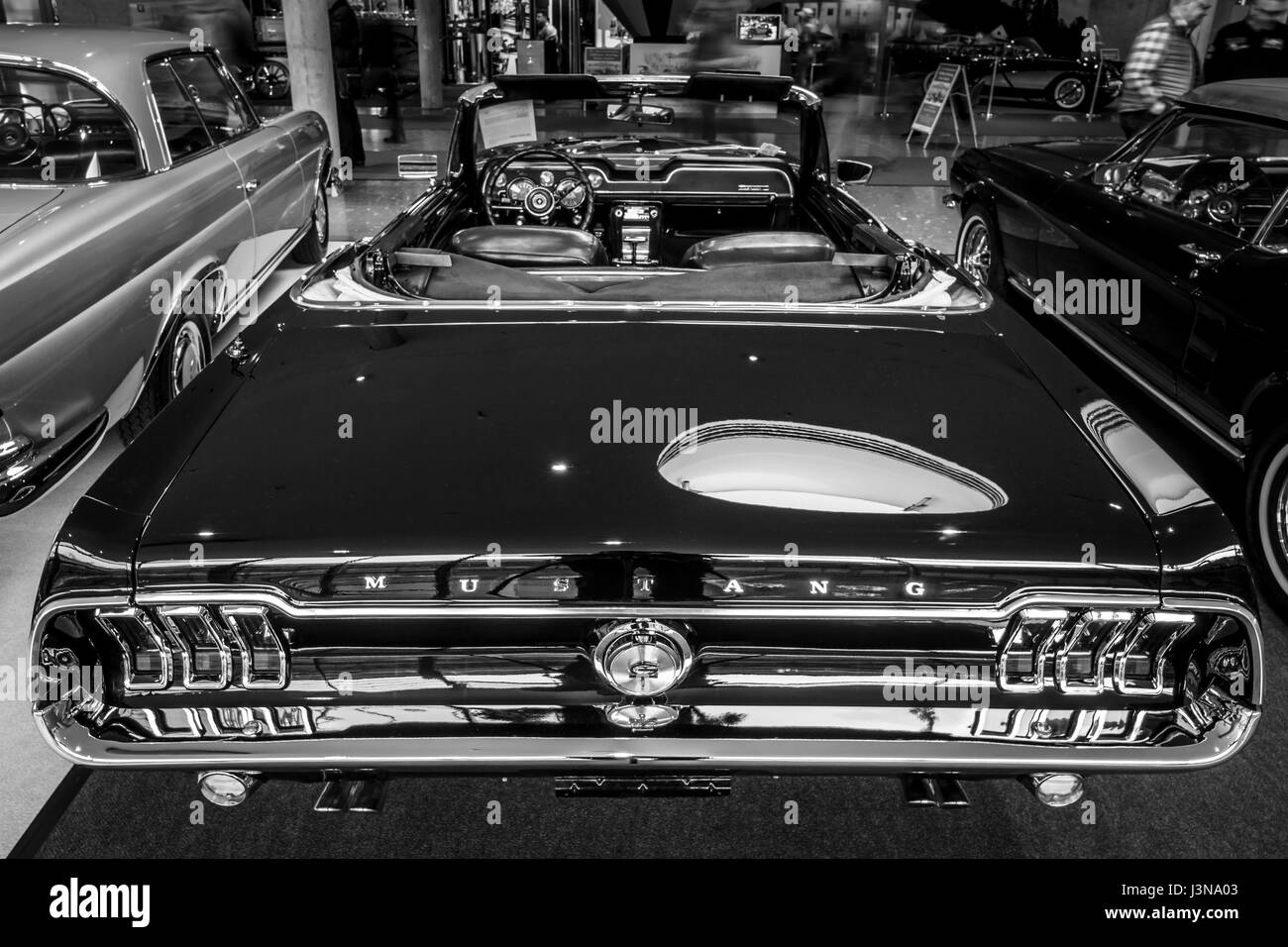 STUTTGART, GERMANY - MARCH 03, 2017: Pony car Ford Mustang V8 Cabrio GT, 1967. Rear view. Black and white. Europe's Stock Photo