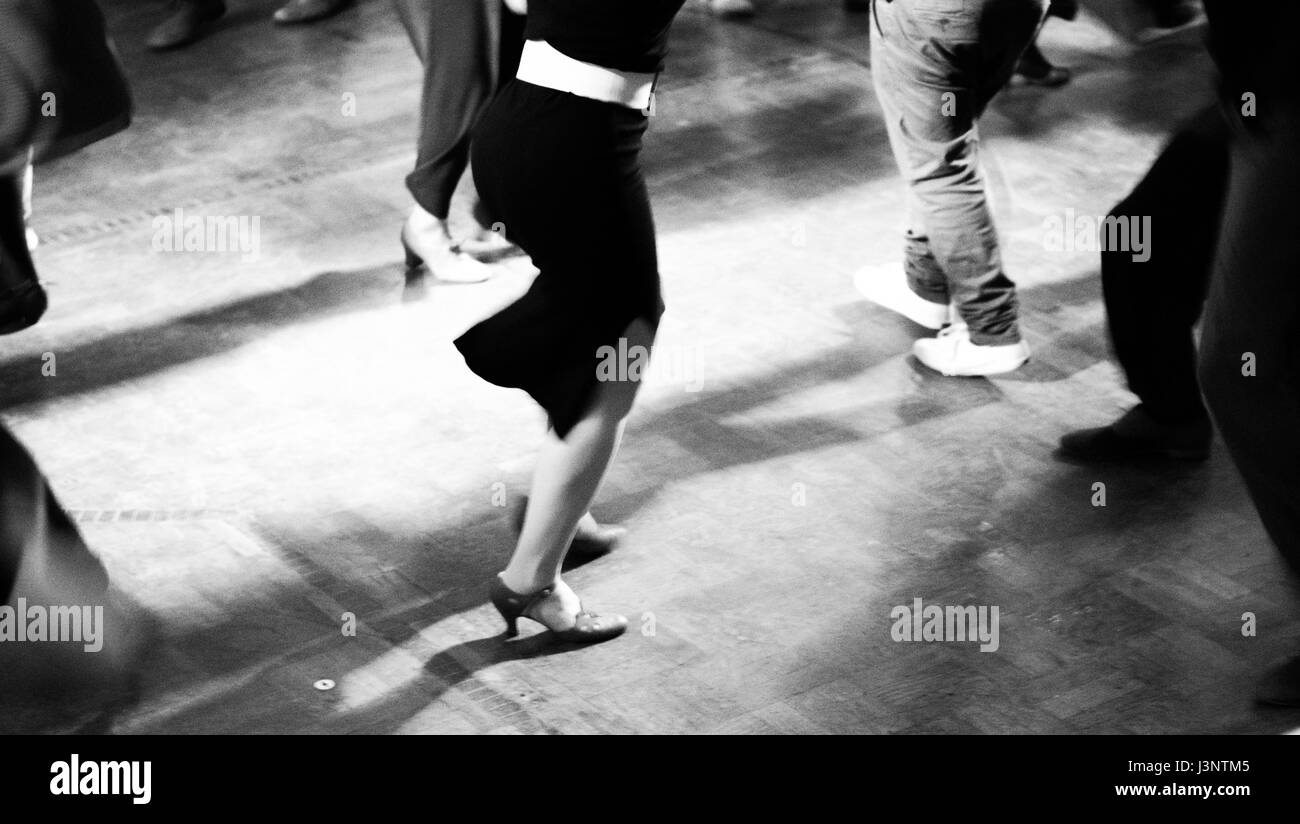 Swing dancers in a ballroom black and white and vintage photo Stock Photo