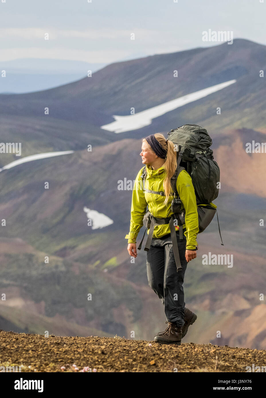 Young woman hiking in Iceland - Stock Image