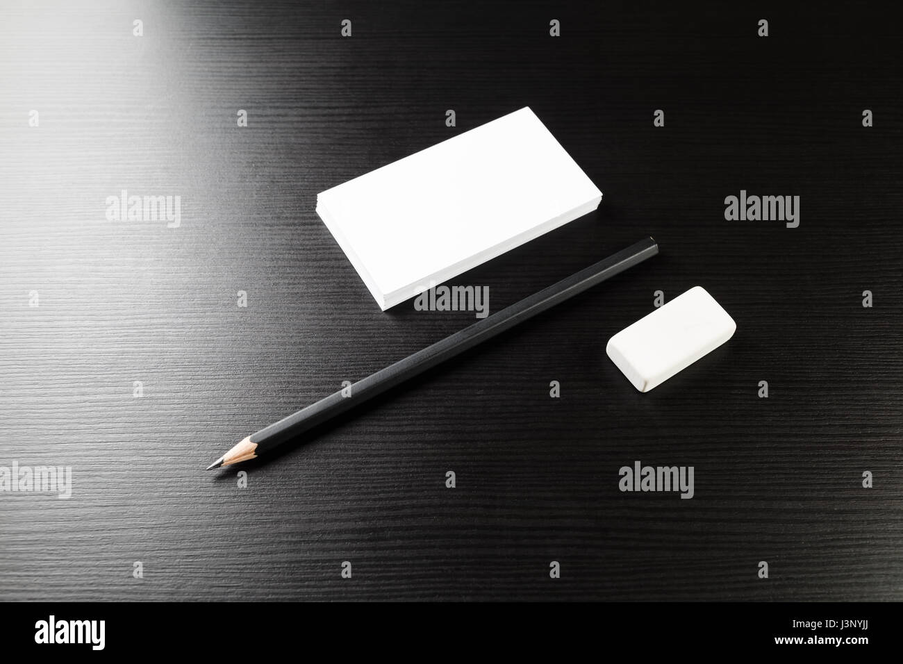 Bank Business Cards Pencil And Eraser On Black Wood Table Background Blank Stationery Template For Design Presentations Portfolios Top View
