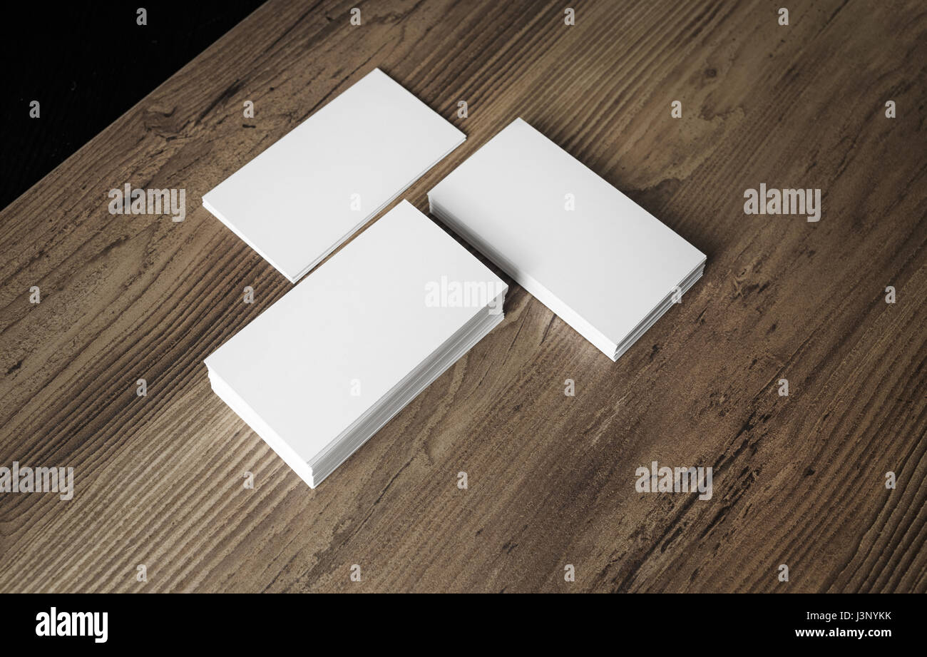 piles of blank business cards on wood background template for your design stacks of blank name cards