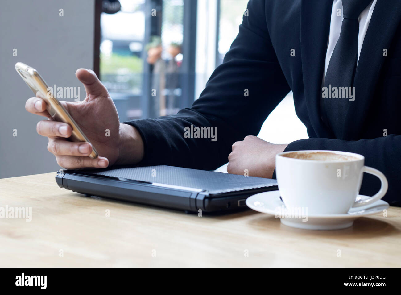business man using internet on smart phone - Stock Image