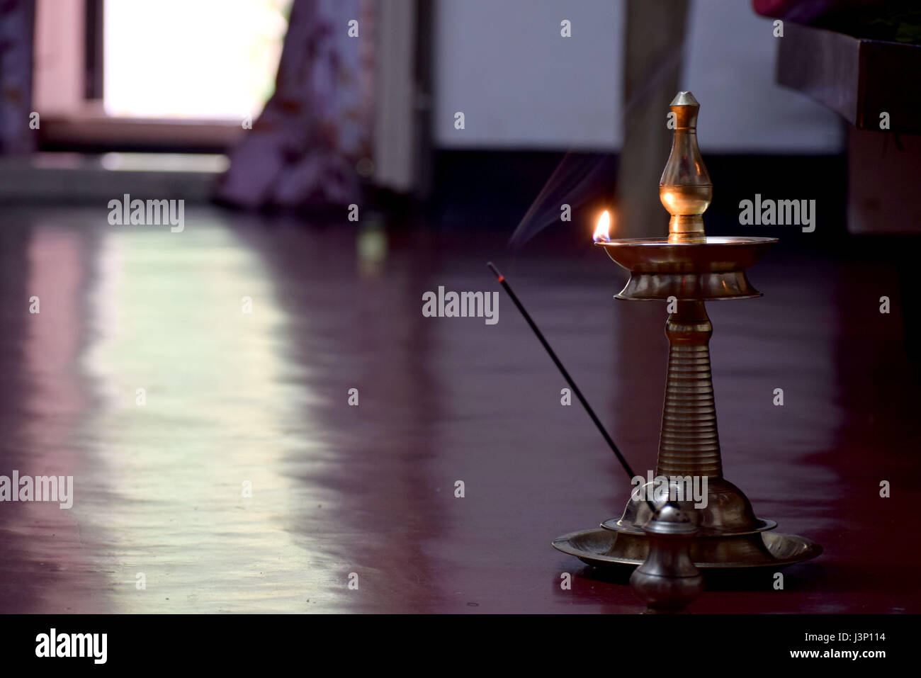 People in India used to light up the lamp everyday morning and evening in devotion to god - Stock Image