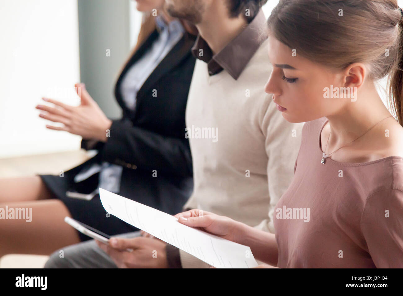 Young people waiting for job interview, audition or training ind - Stock Image