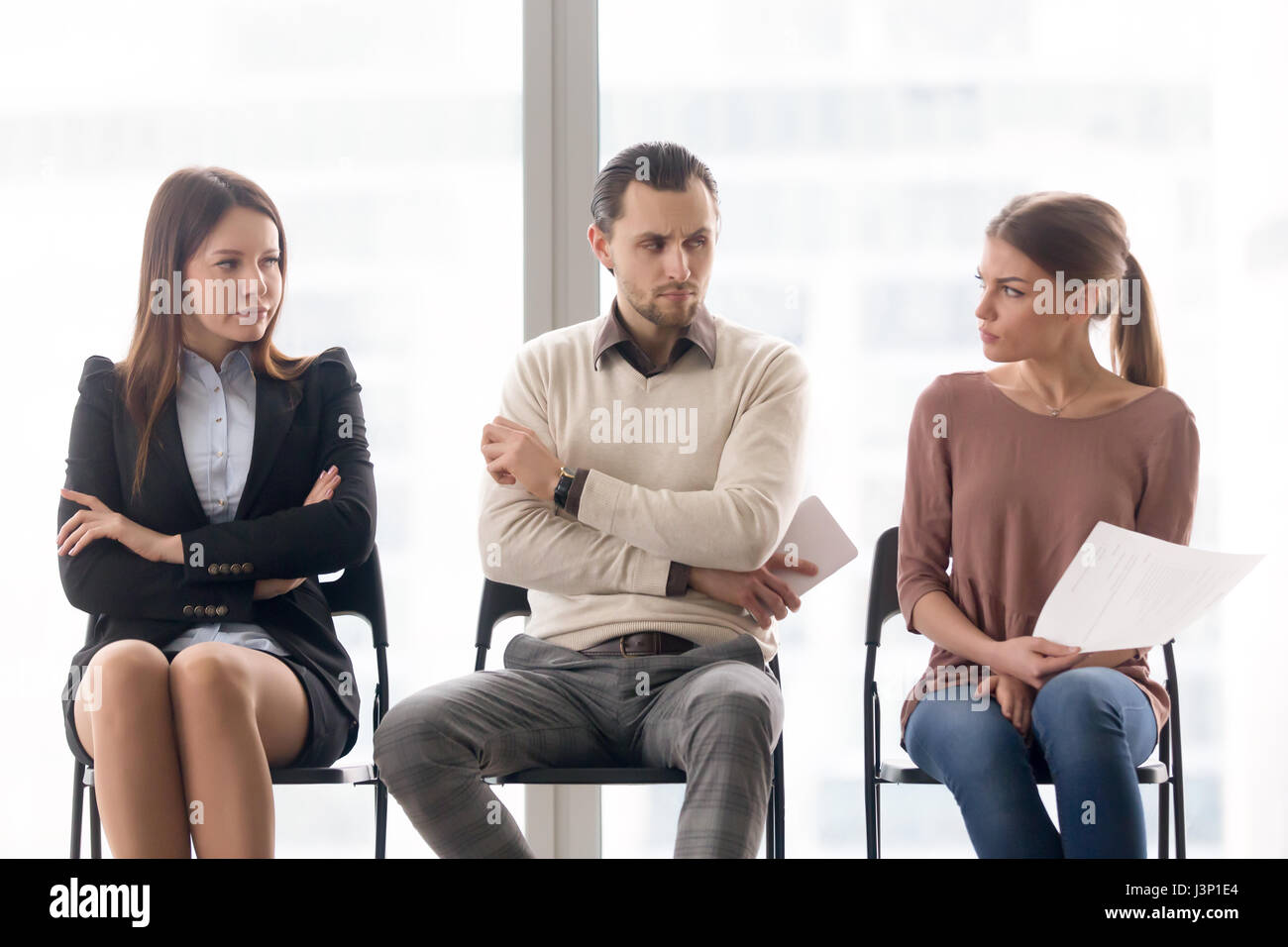 Rivalry and competition between businesspeople, applicants waiti - Stock Image