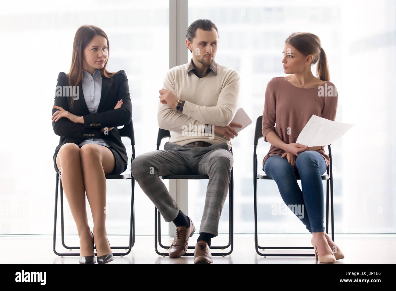 Job seekers compete for position, rivalry and competition betwee - Stock Image