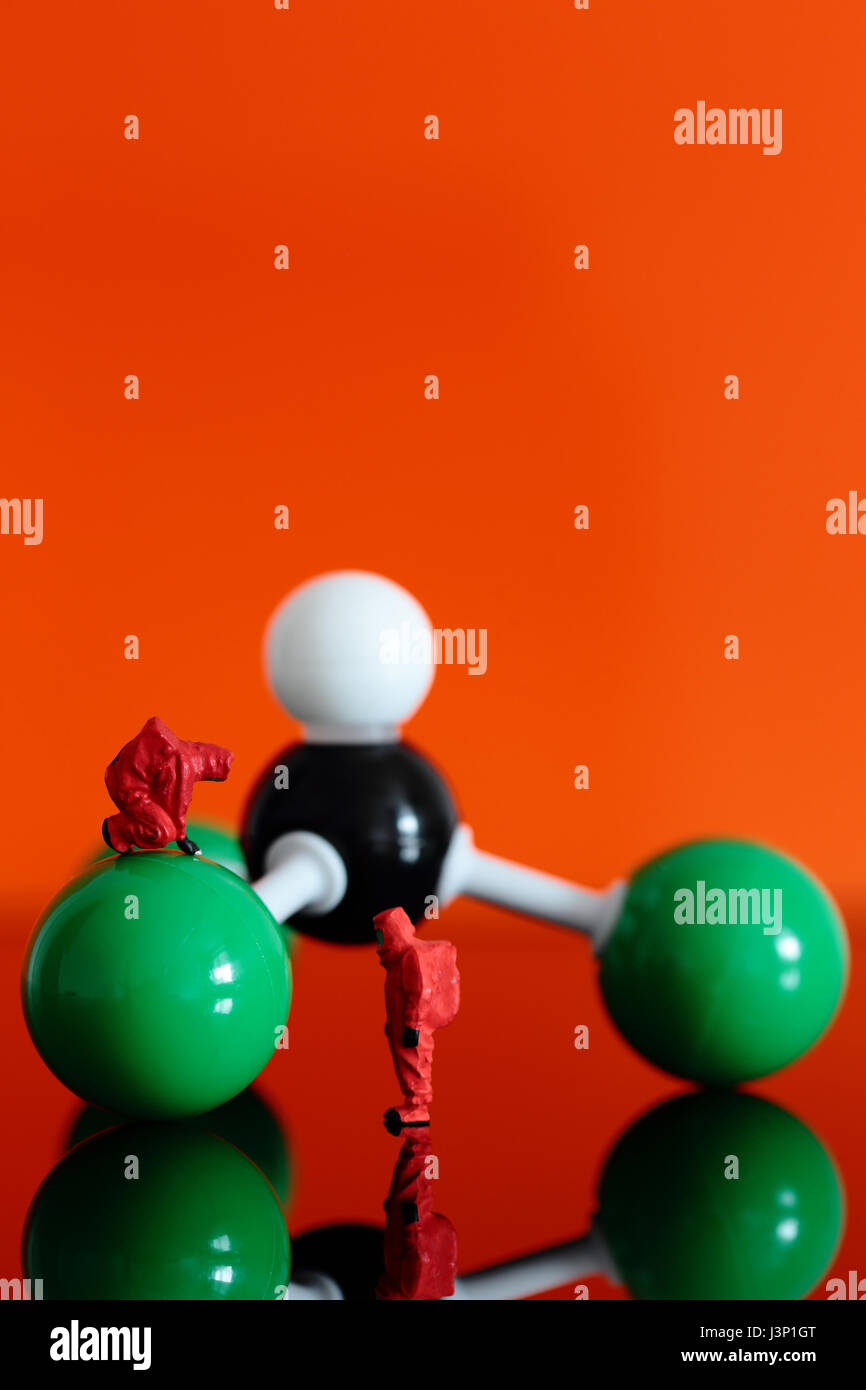 Miniature model chemical team with a molecular model of chloroform - Stock Image