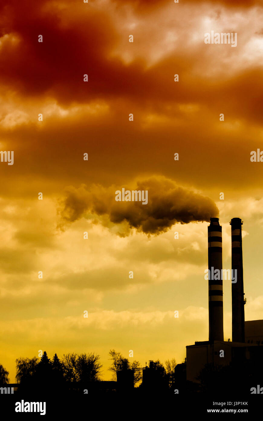 industrial plant and smoke from chimney, polluting air concept - Stock Image