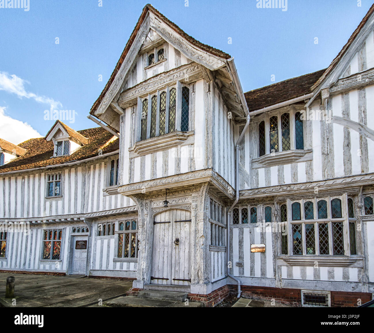 Half timbered Guildhall in Lavenham, Suffolk dating from the sixteenth century. - Stock Image