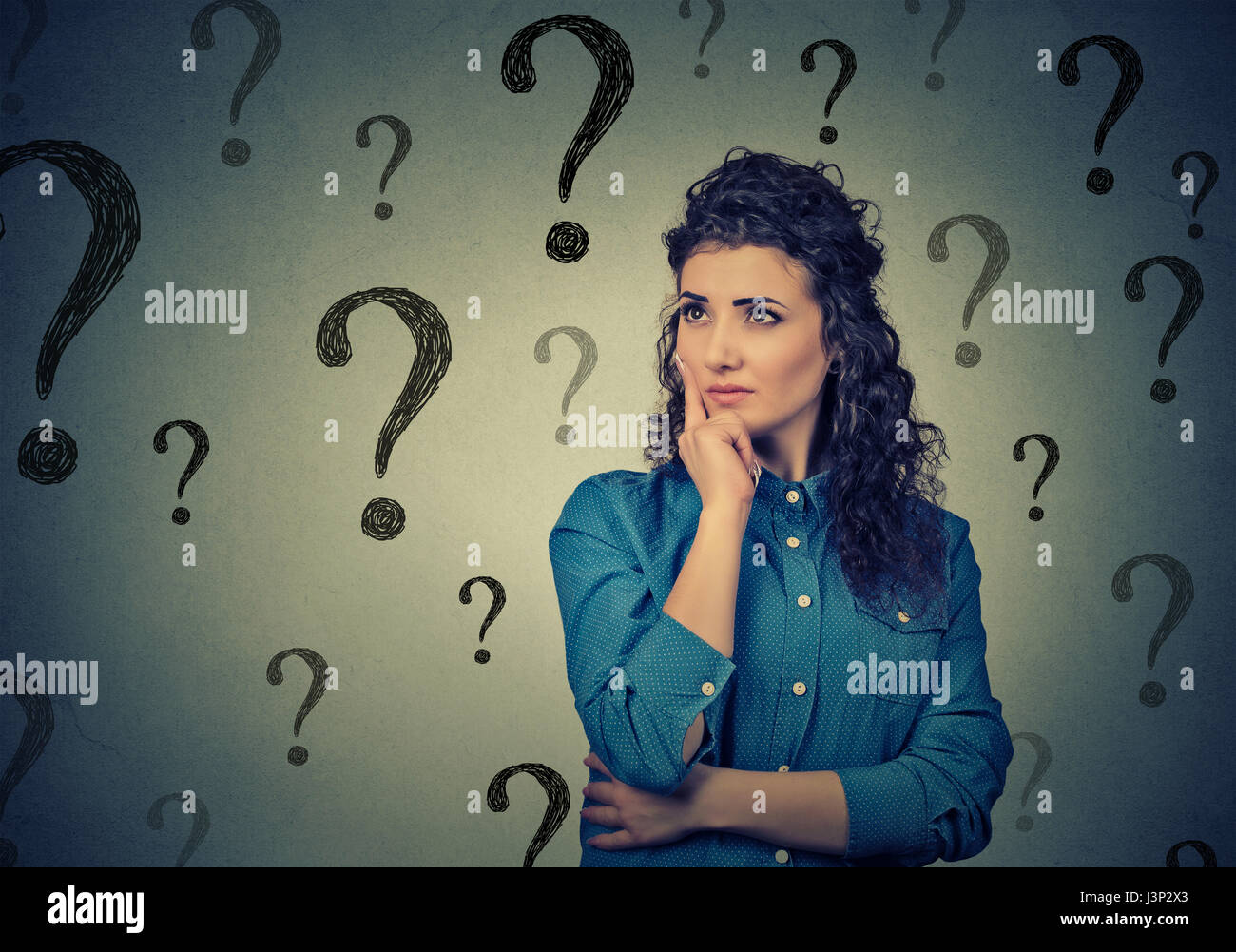 Portrait confused woman bewildered needs a solution has many questions isolated on gray background. Human face expression Stock Photo