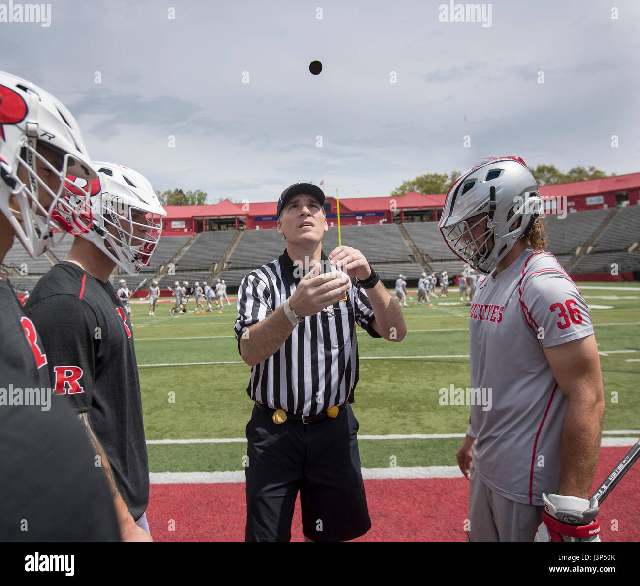 Coin toss before a lacrosse match between Ohio State and Rutgers at High Point Solutions Stadium in New Jersey - Stock Image