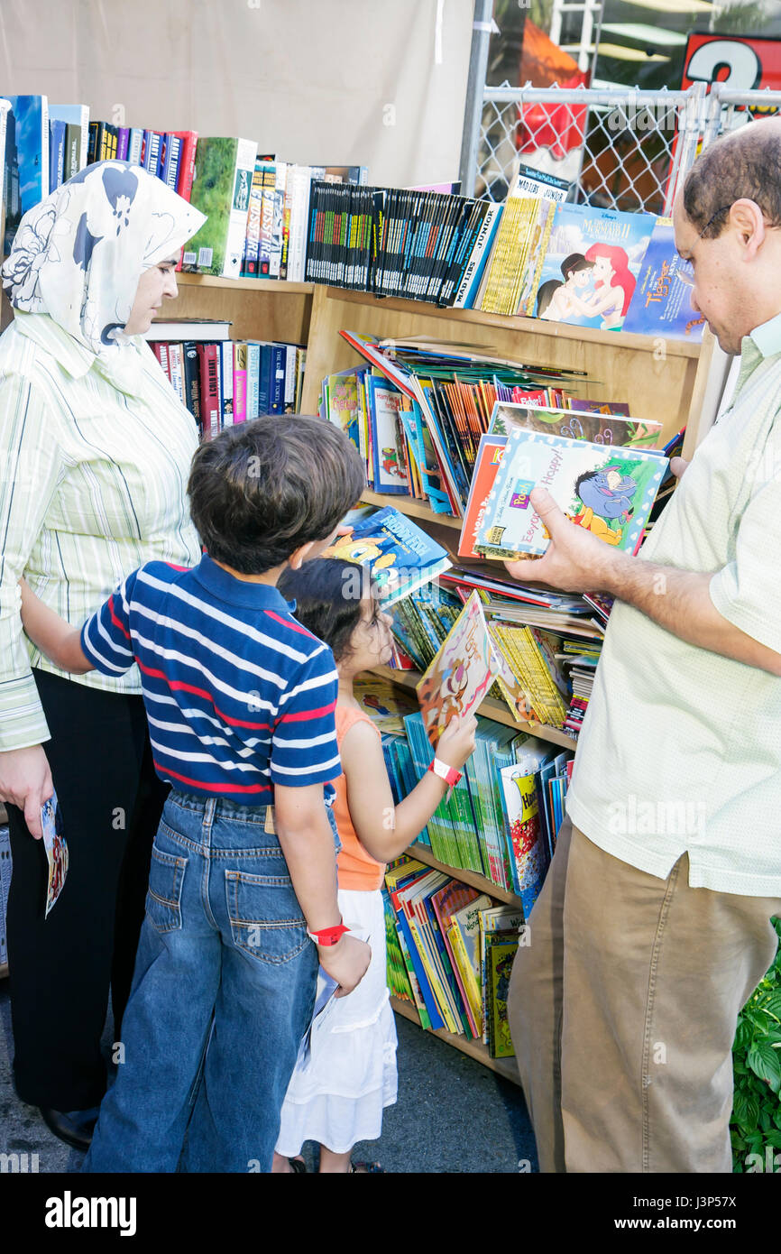 MiamiMiami Florida-Dade College Miami Book Fair International Muslim man woman girl boy family mother father child - Stock Image