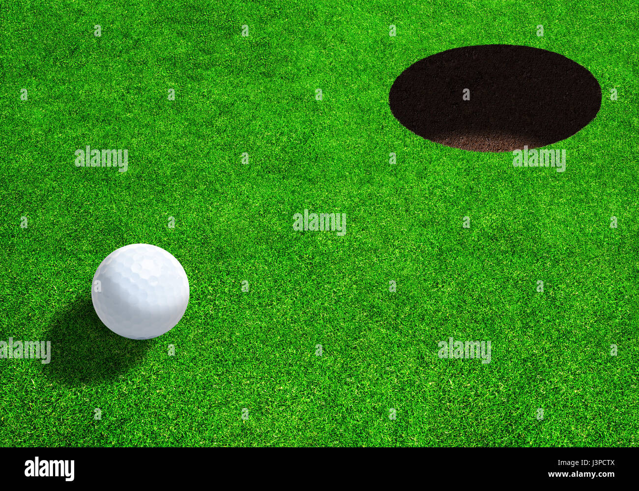 Golf ball close to hole on beautiful golf greens ready for par, eagle or bogey with copy space. - Stock Image