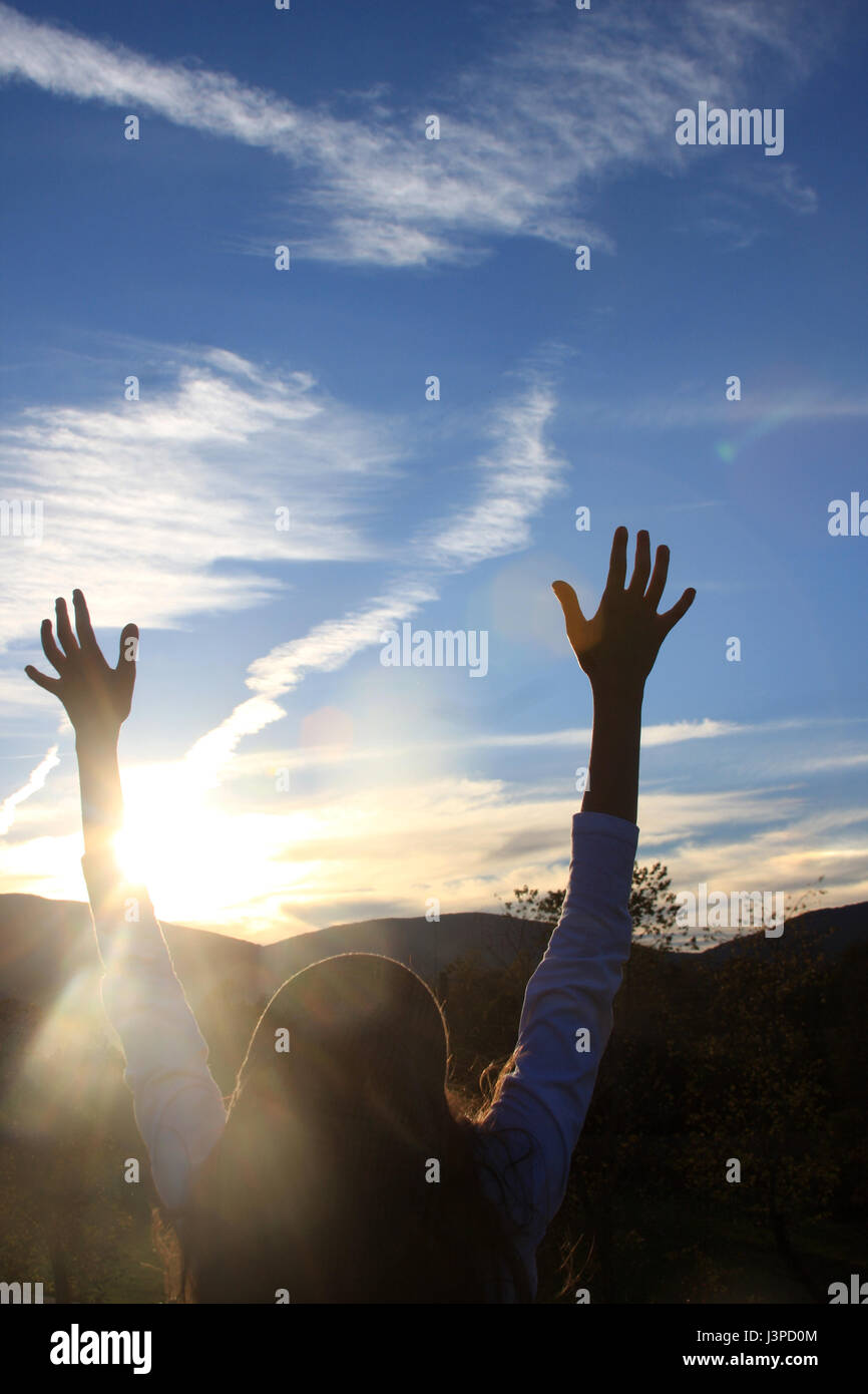 Girl's hands reaching for the sky - Stock Image