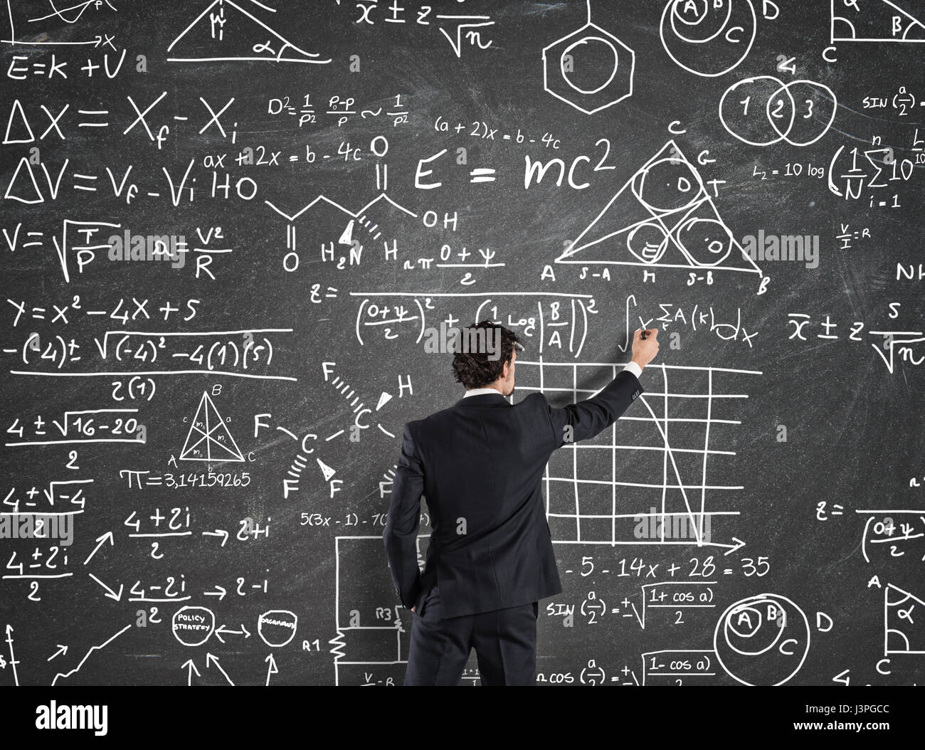 Businessman solve problems with Math calculations - Stock Image
