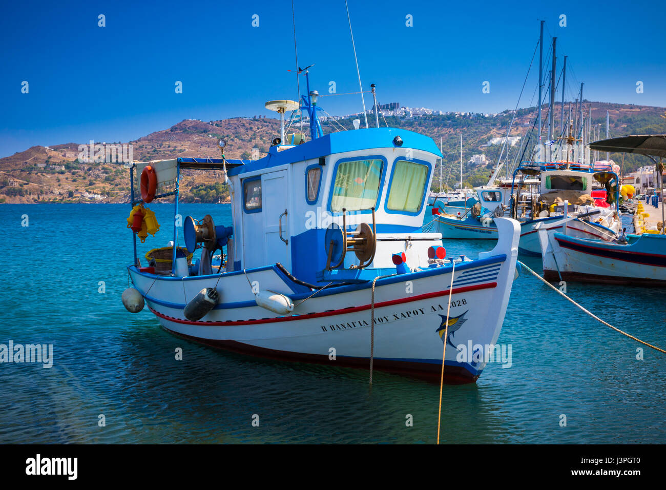 Fishing boat in the harbor on the greek island of Patmos - Stock Image