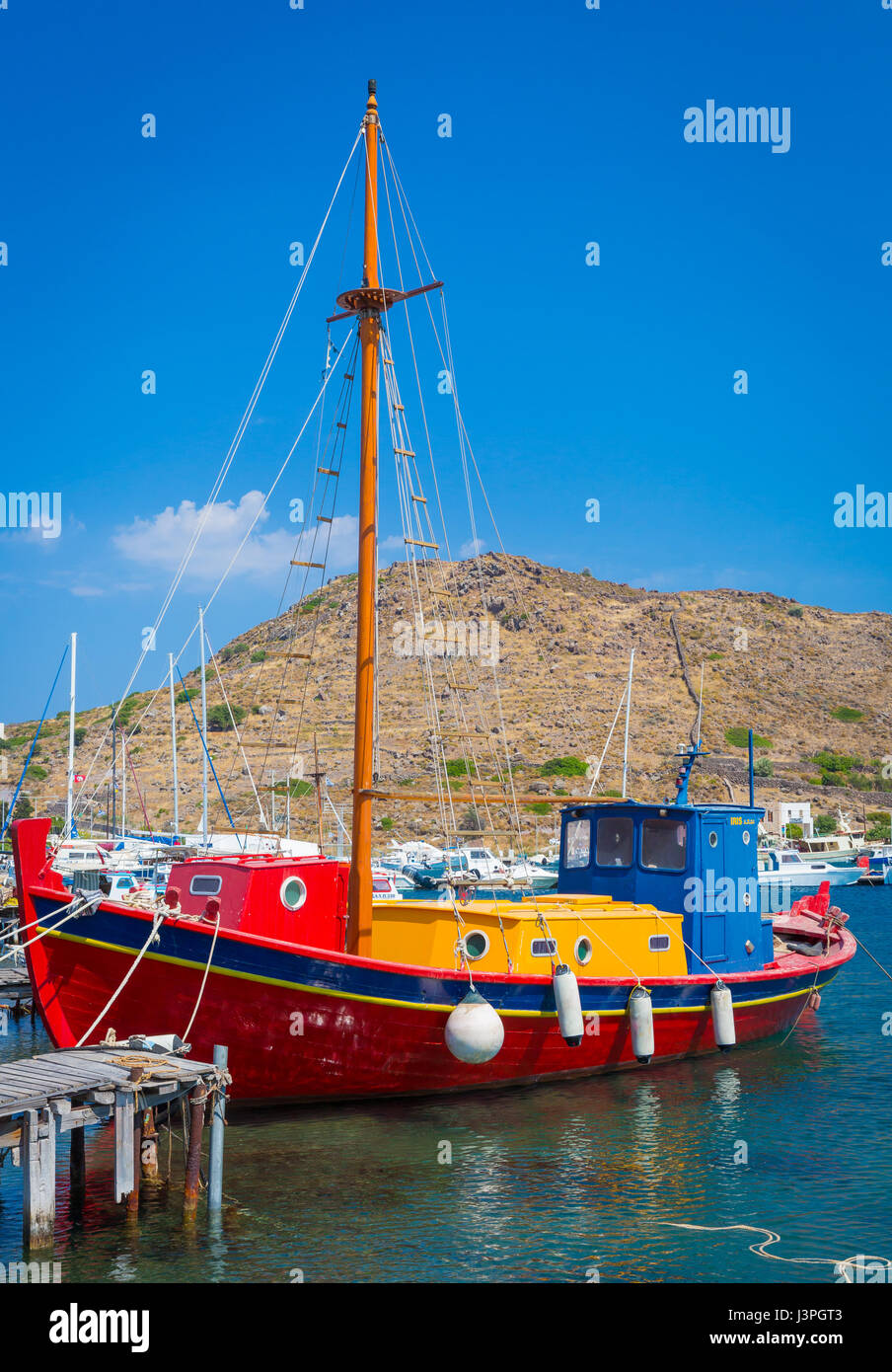 Boat in the harbor on the greek island of Patmos - Stock Image
