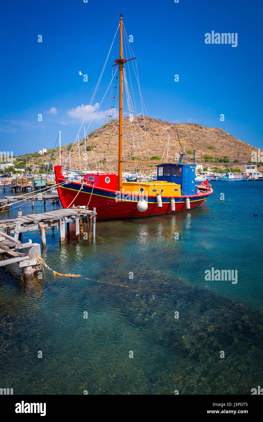 Boat in the harbor on the greek island of Patmos Stock Photo