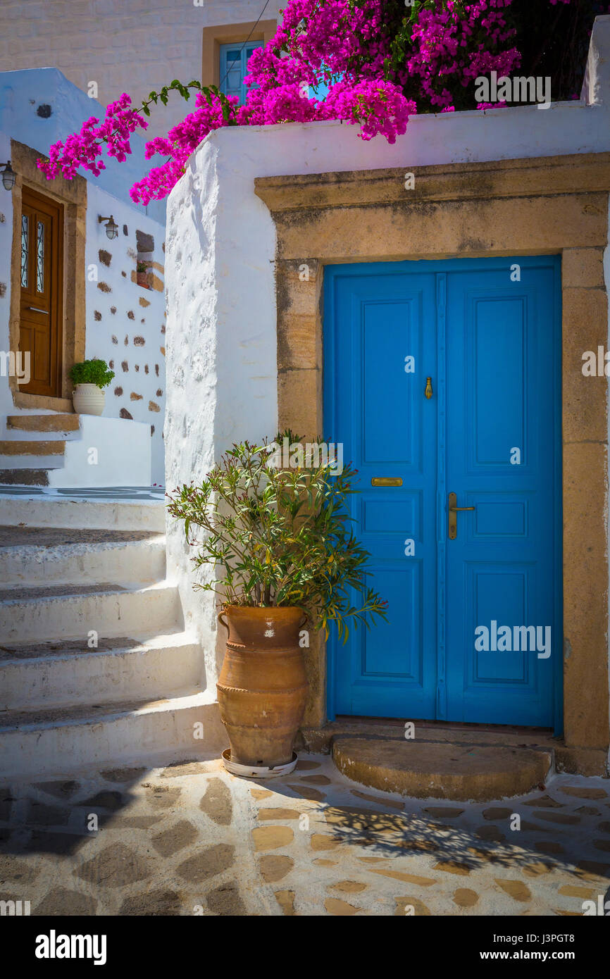Doors and staircase in the Skala town of the greek island Patmos in the Skala town of the greek island Patmos - Stock Image