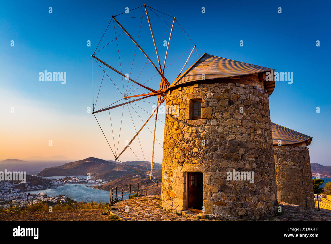Windmills on the Greek island of Patmos. Patmos is a small Greek island in the Aegean Sea, most famous for being - Stock Image