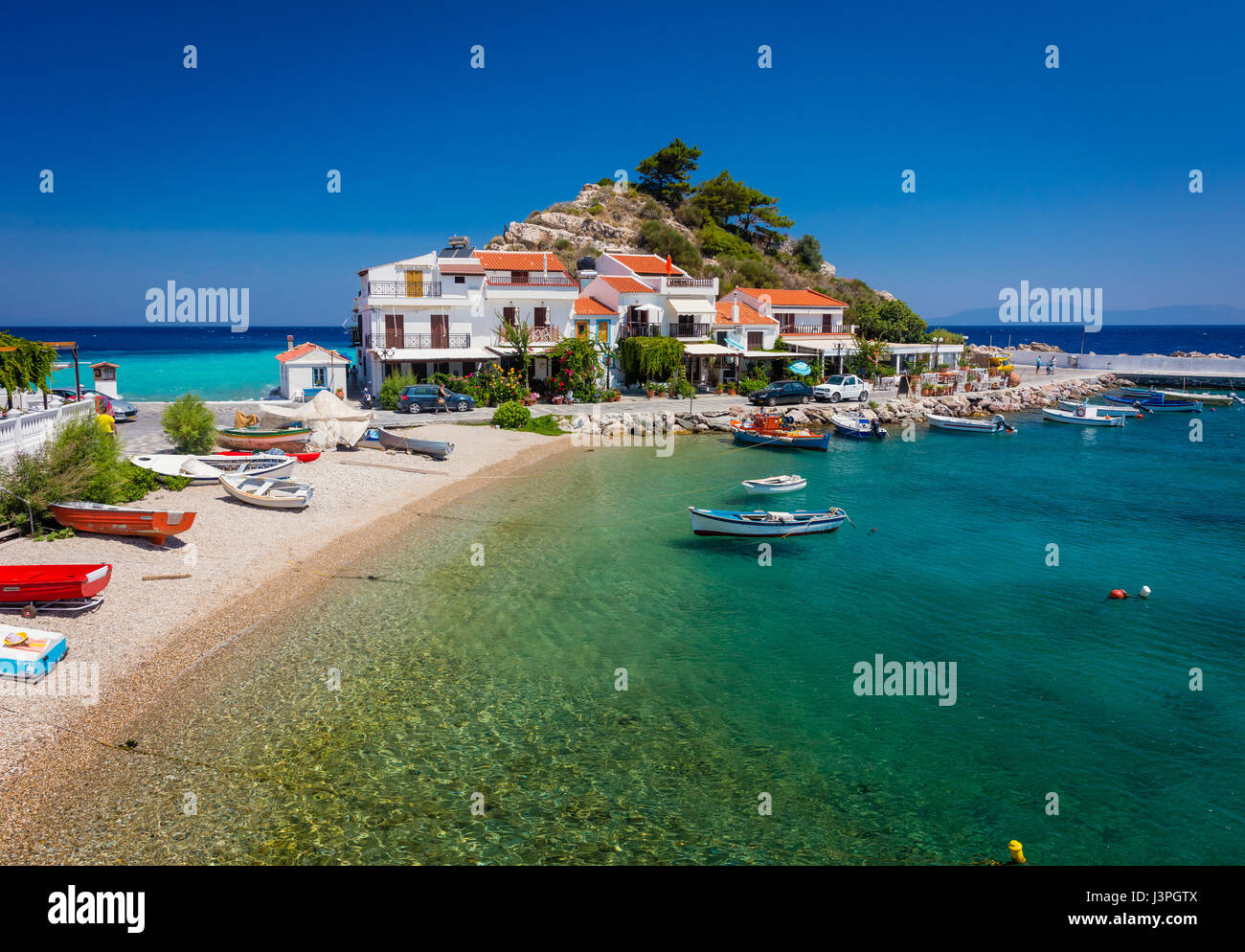 Kokkari is a fishing harbour of Samos Island, which has now developed into a tourist center. Still, it preserves - Stock Image