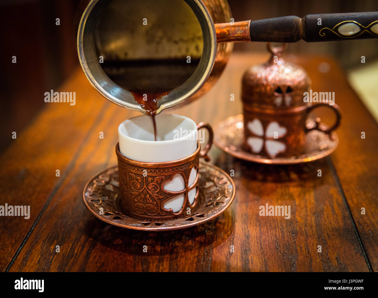 Turkish coffee (Turkish: Türk kahvesi) is a method of preparing unfiltered coffee. Roasted and then finely - Stock Image