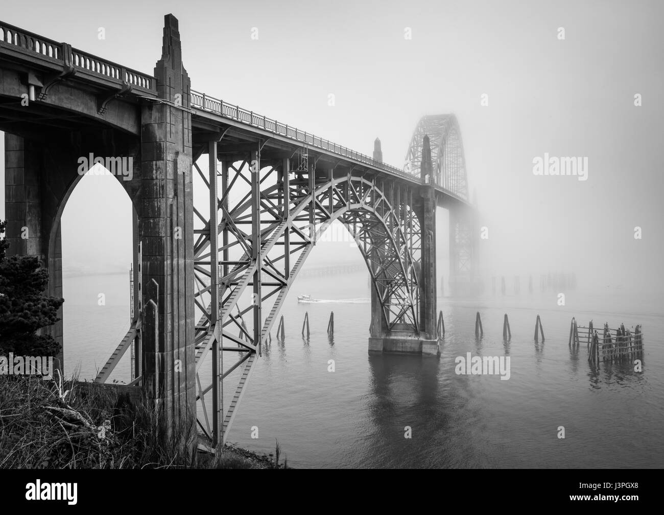 The Yaquina Bay Bridge is an arch bridge that spans Yaquina Bay south of Newport, Oregon. It is one of the most - Stock Image
