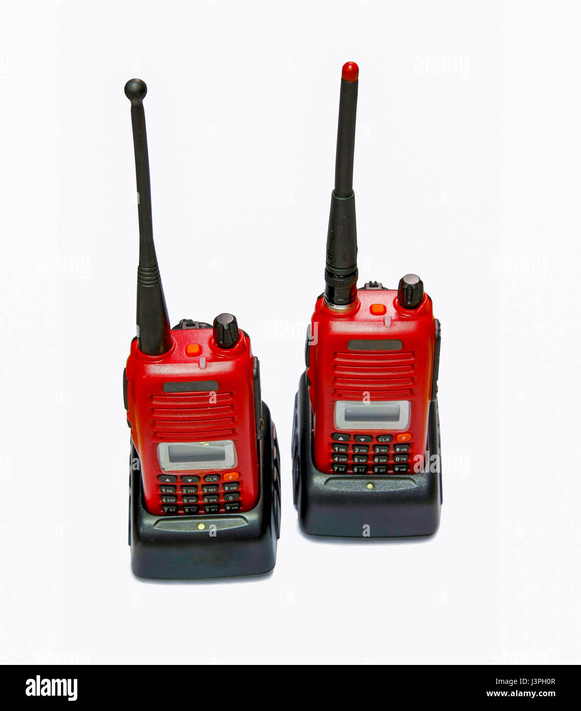 two red radio communication in chargers on white background Stock Photo