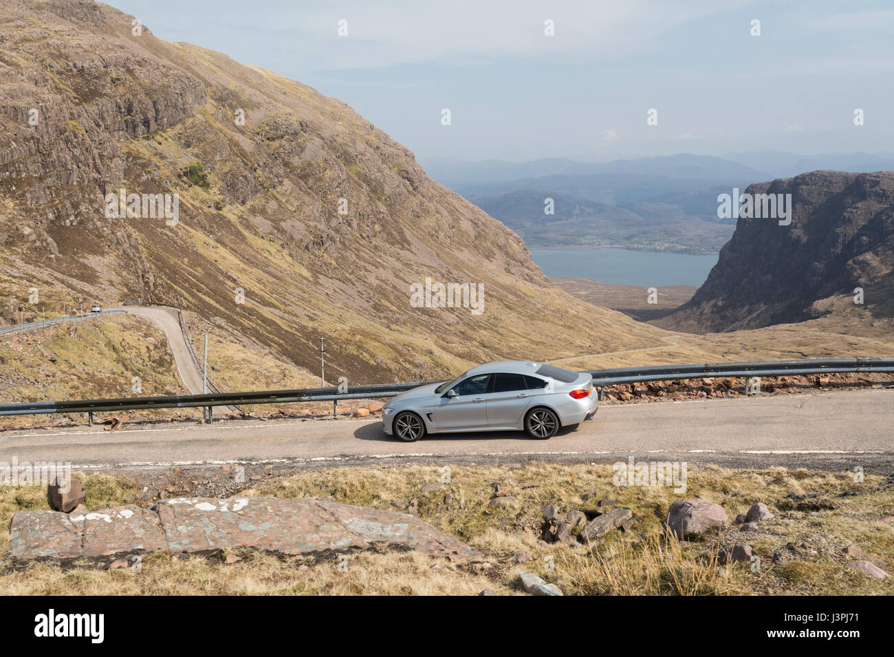 North Coast 500 route - car on Bealach na ba road, Applecross, Highland, Scotland, UK - Stock Image