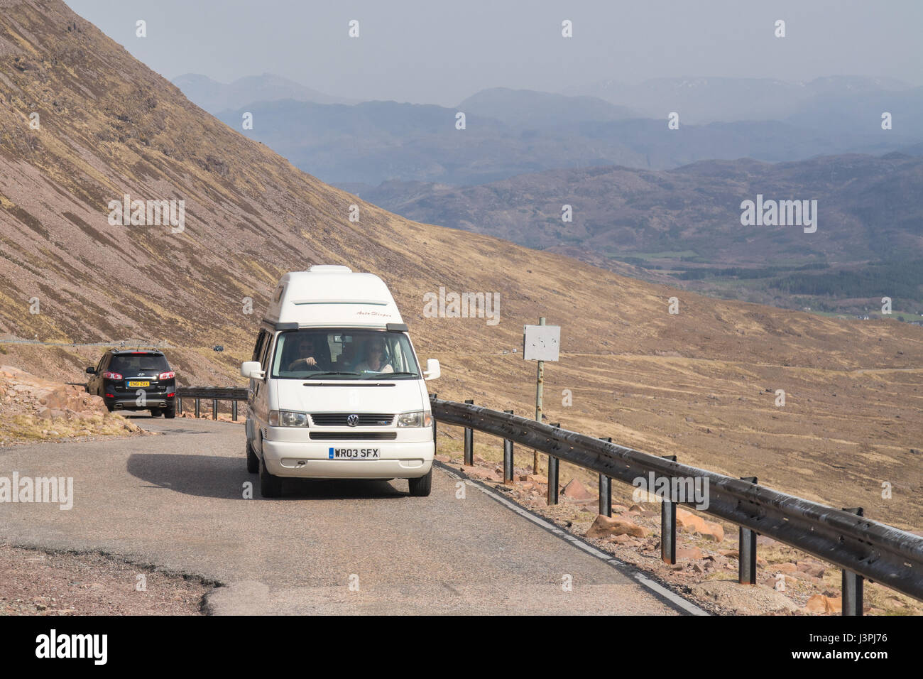 Bealach na ba road - part of the North Coast 500 route - camper van waiting at passing place for oncoming vehicle, - Stock Image