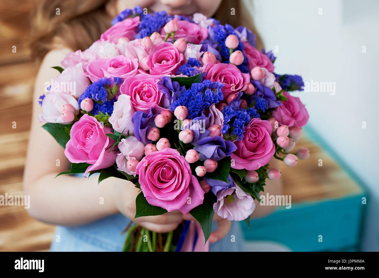 Wedding bouquet in pink and purple tones. Beautiful and delicate. In the children's handles. - Stock Image