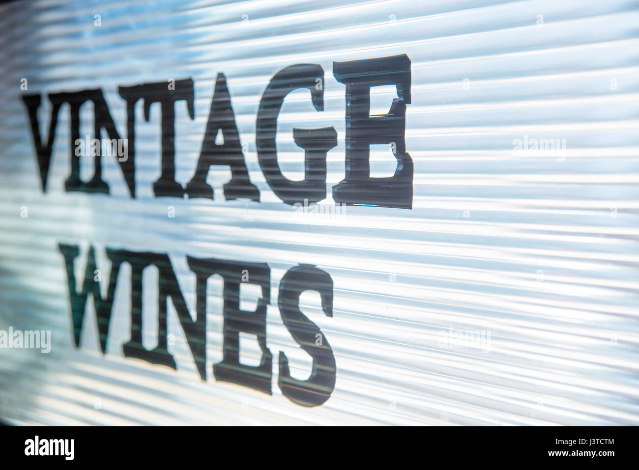 Vintage wines, written on glass surface. - Stock Image