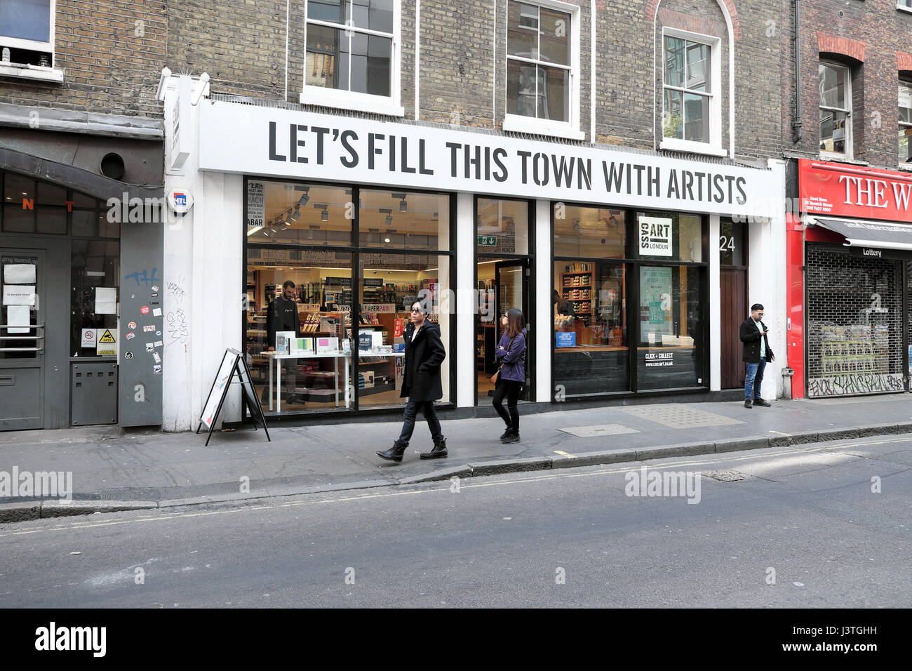 """Let's Fill This Town With Artists"" sign on Cass Art shop in Wardour Street, Soho, London UK   KATHY DEWITT Stock Photo"