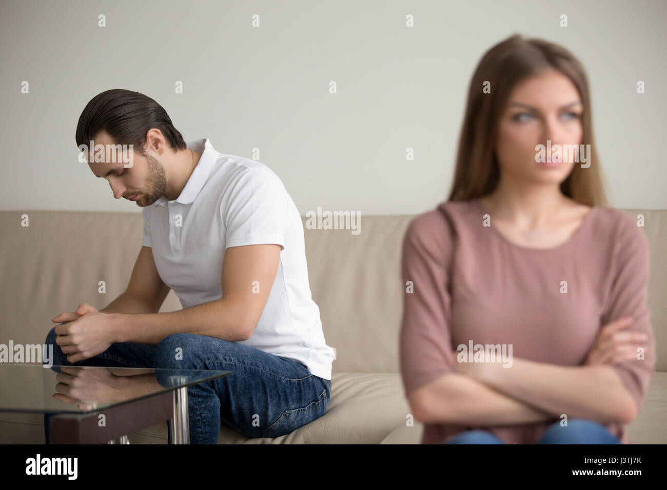 Sad depressed husband offended wife in quarrel, feeling guilty f - Stock Image