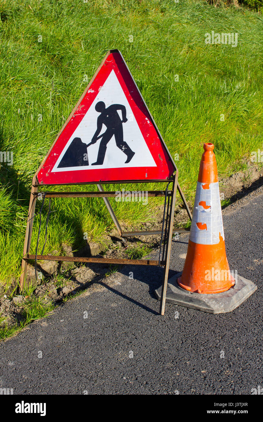 Triangular road sign marking minor road works on a side road in Groomsport Northern Ireland Stock Photo