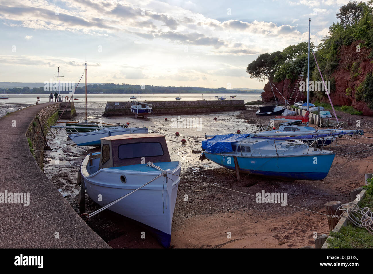 Low tide River Exe & Lympstone harbour with Starcross Yacht Club across the estuary viewed by couple - Stock Image