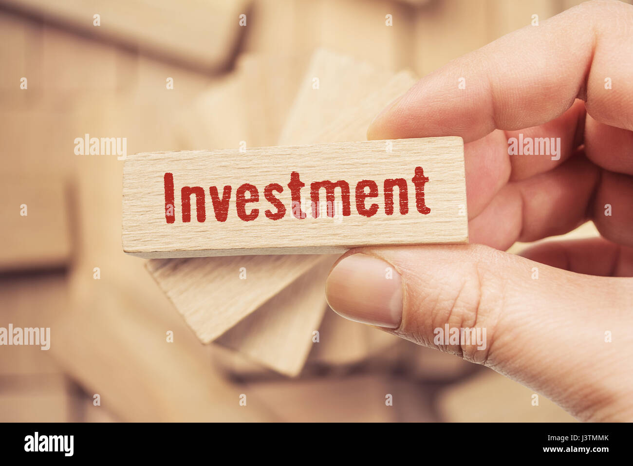 investment word written on wood block - Stock Image