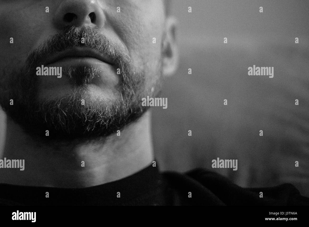 Black and white grainy portrait of a middle-aged bearded man - Stock Image