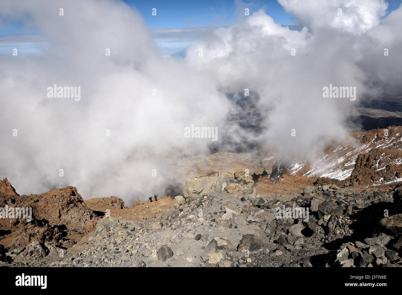 Two porters climbing the Western Breach, Kilimanjaro National Park, Tanzania Stock Photo