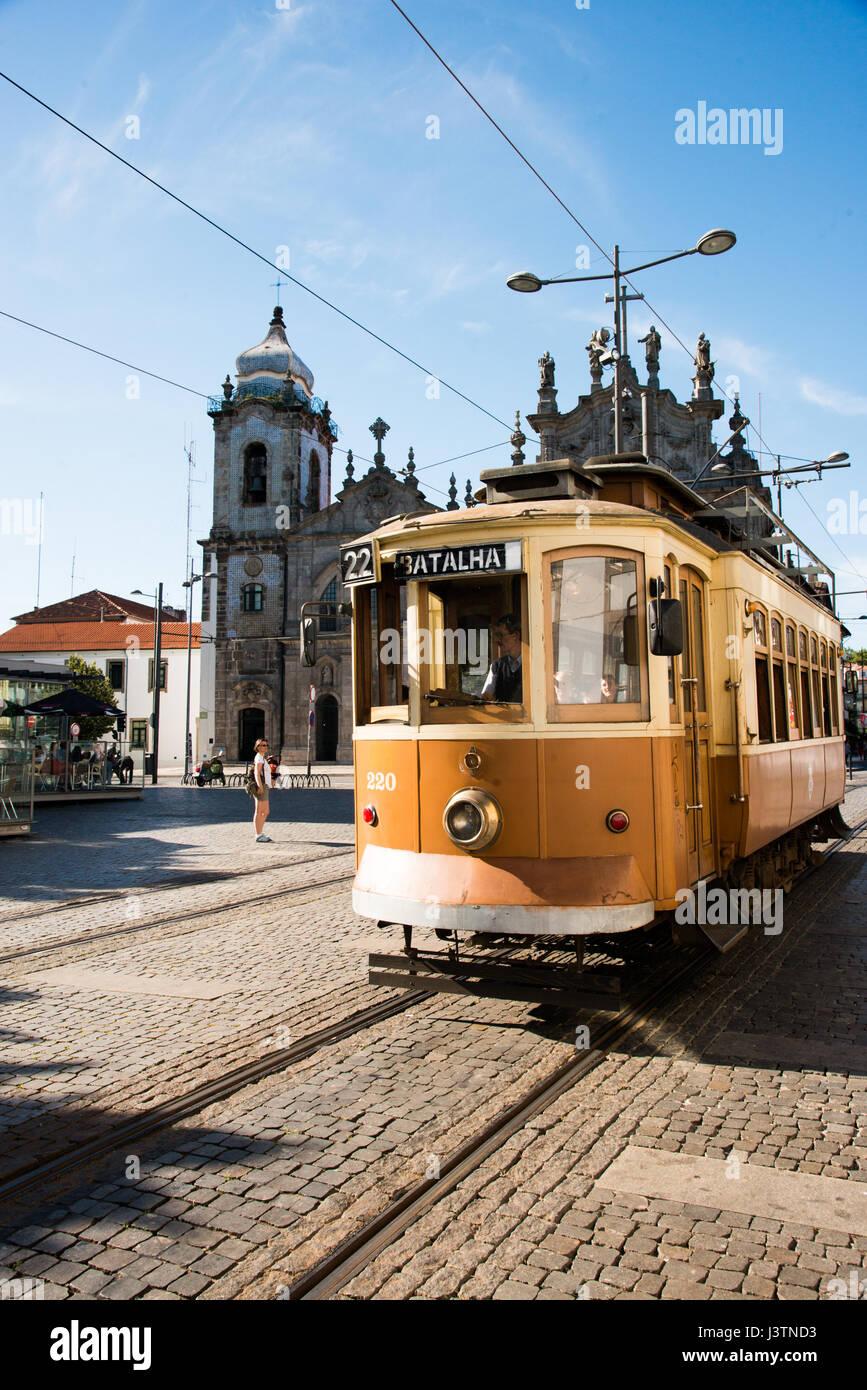 Old tram in front of church in Porto Stock Photo