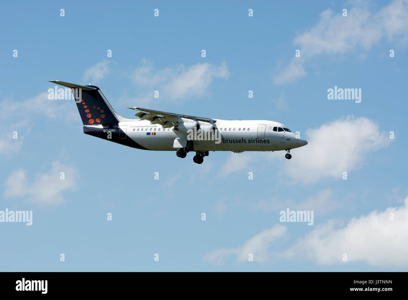 A Brussels Airlines Avro RJ100 landing at Birmingham Airport, UK - Stock Image