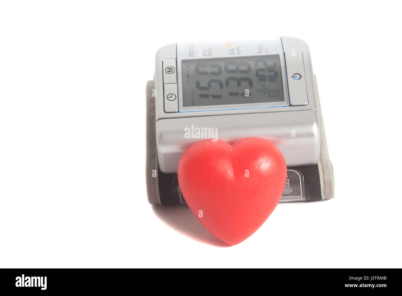 Digital blood pressure meter with  heart symbol isolated on white background - Stock Image