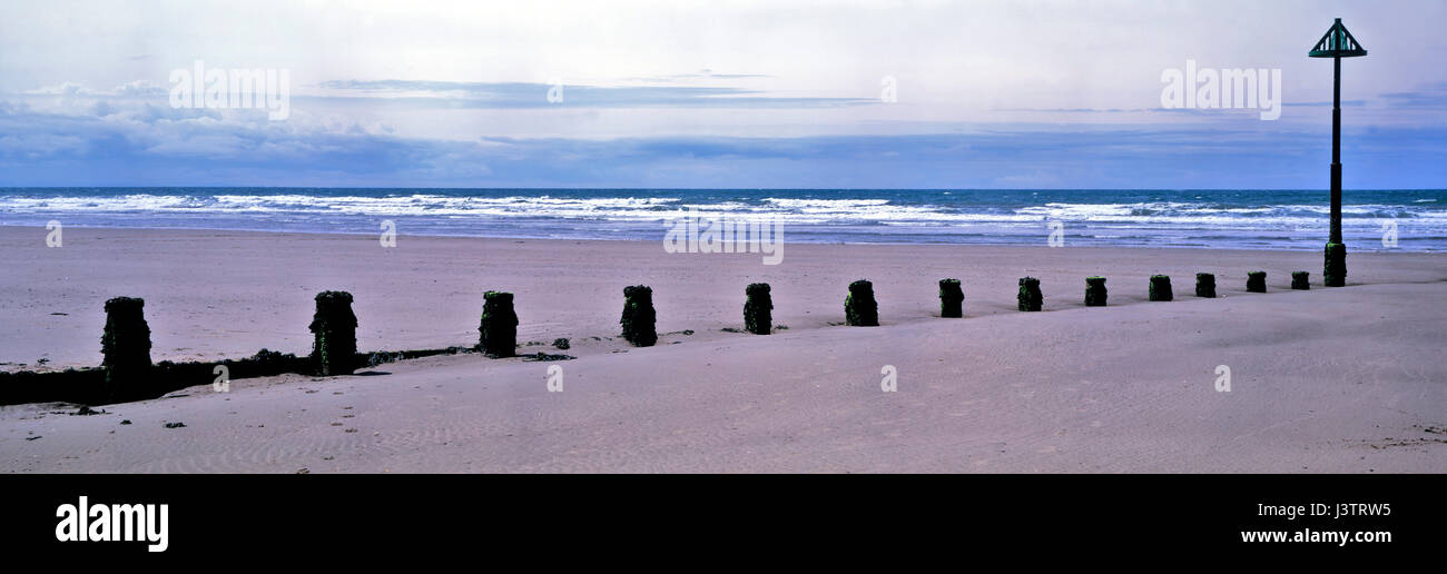 A panoramic view of the Beach and Groins at Borth in Mid Wales - Stock Image