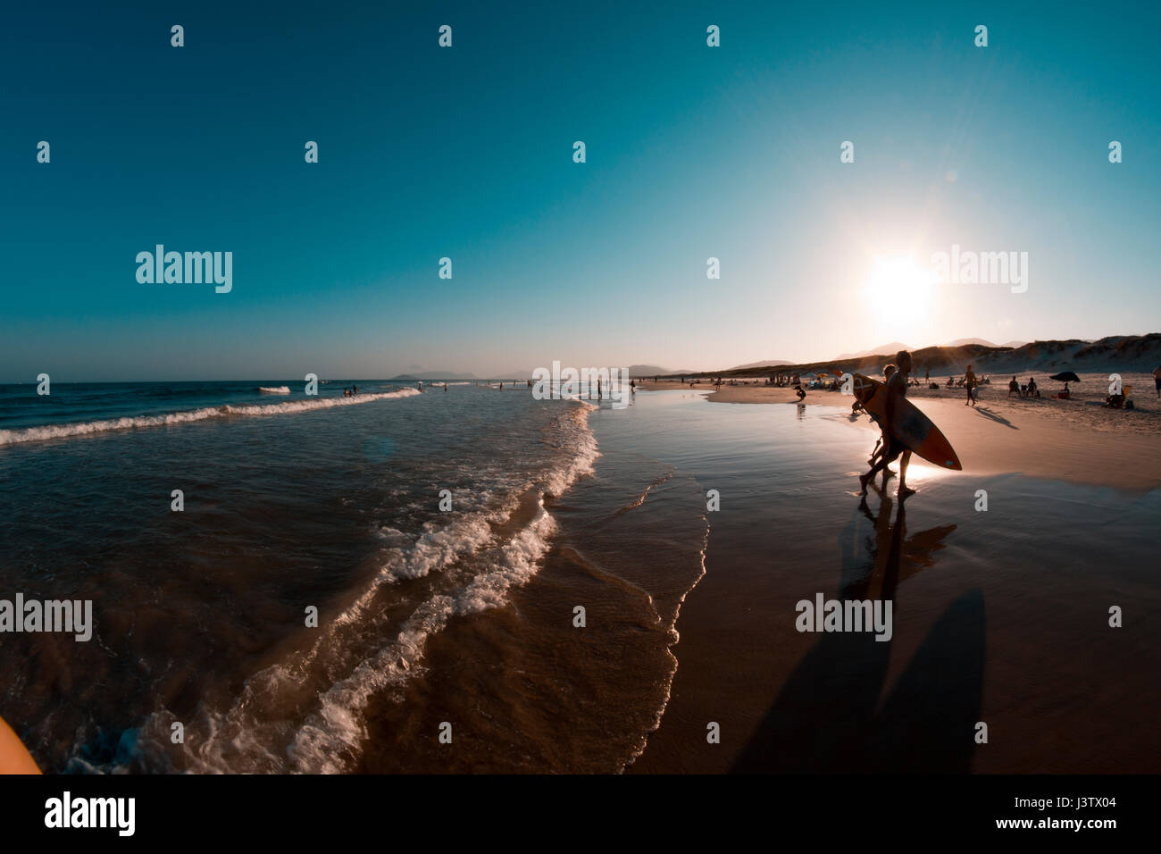 surfer at the beach of sao joaquim, florianopolis, brazil - Stock Image