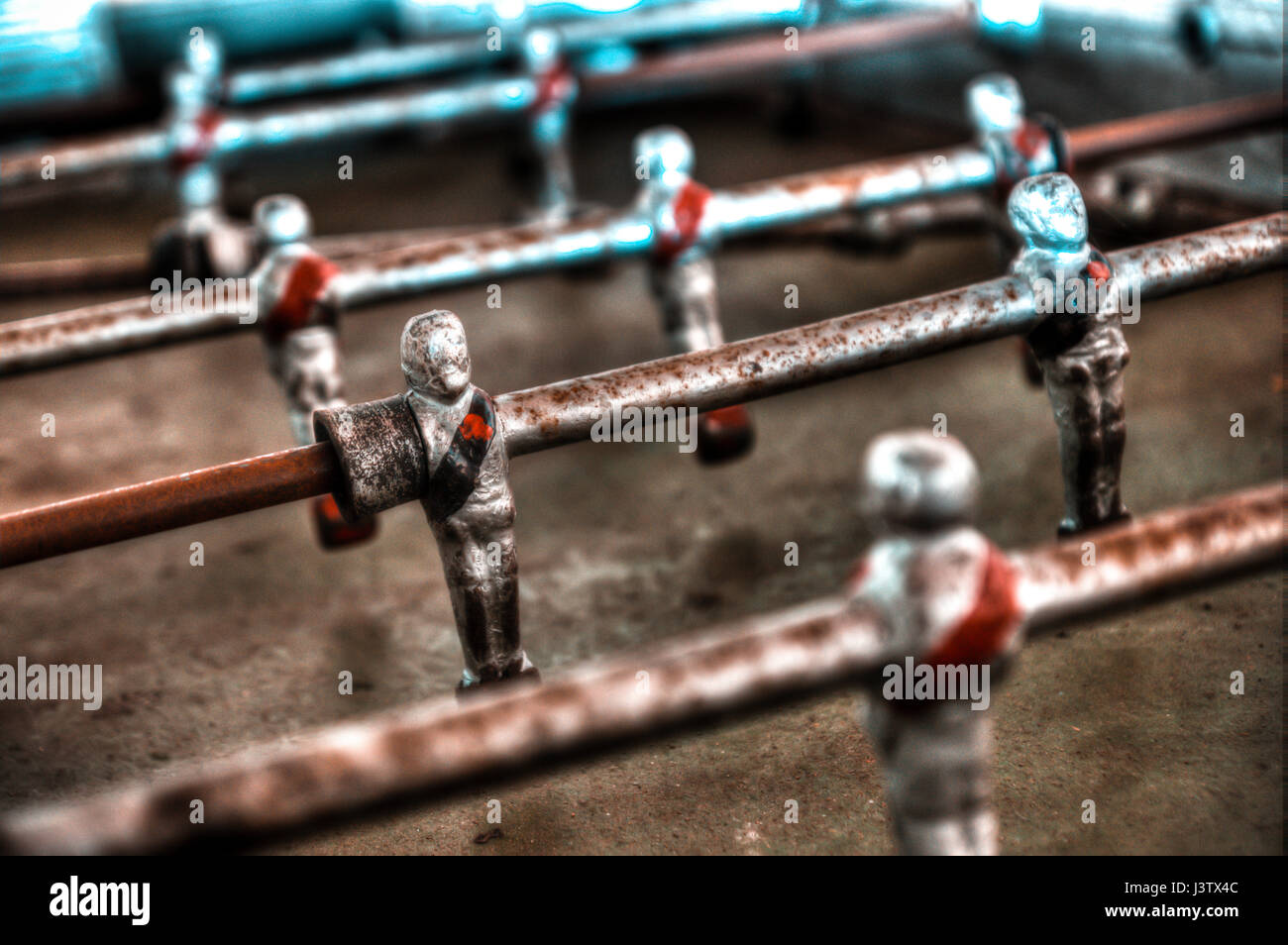 Old table football kicker with rusty characters - Stock Image